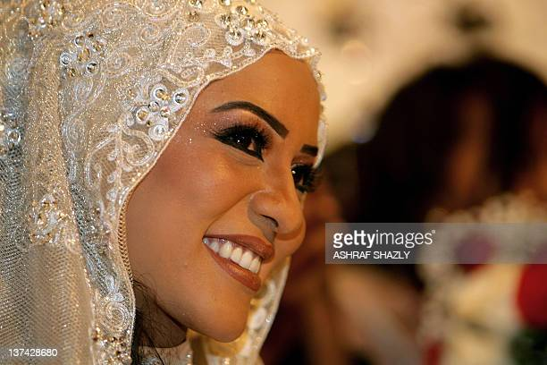 Amani daughter of Sudan's Janjaweed militia leader Mussa Hilal smiles during her wedding celebrating her marriage to Chadian President Idriss Deby in...