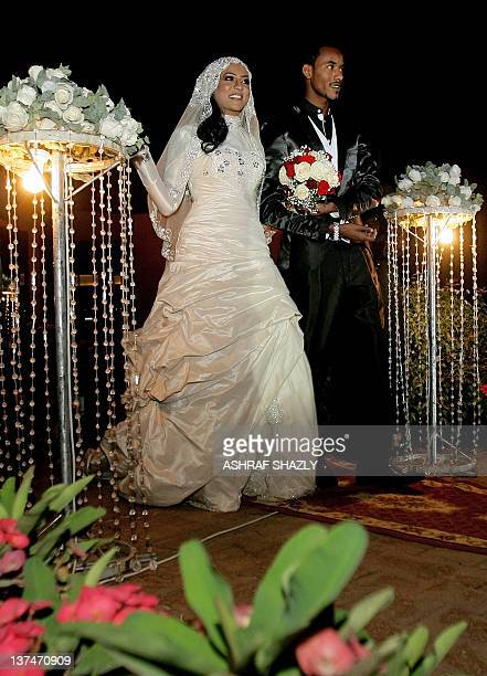 Amani Hilal daughter of Sudan's Janjaweed militia leader Mussa Hilal arrives with her brother Habib Hilal to her wedding party in Khartoum on January...
