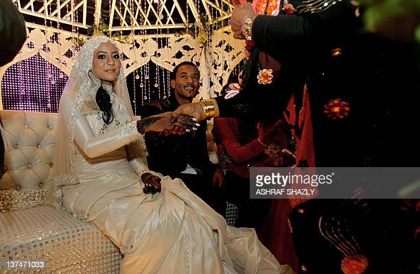 Amani Hilal daughter of Sudan's Janjaweed militia leader Mussa Hilal is congratulated by a guest as she sits with her brother Habib Hilal during her...