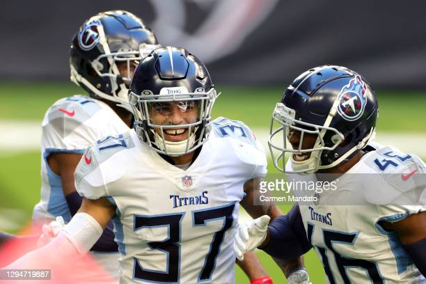Amani Hooker and Joshua Kalu of the Tennessee Titans in action against the Houston Texans during a game at NRG Stadium on January 03, 2021 in...