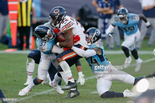 Amani Hooker and Kenny Vaccaro of the Tennessee Titans combine on David Montgomery of the Chicago Bears during the fourth quarter at Nissan Stadium...