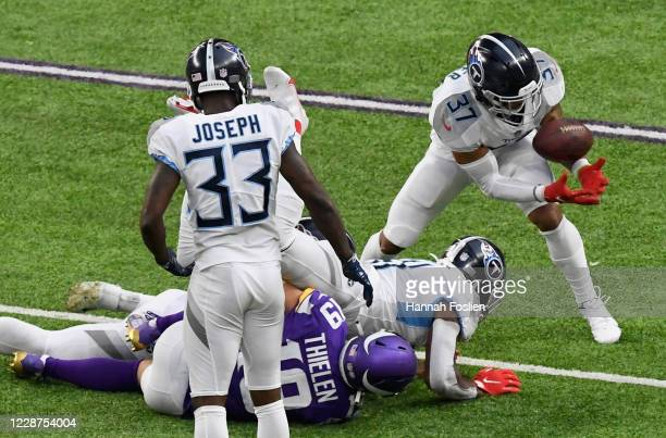 Amani Hooker of the Tennessee Titans intercepts a pass intended for Adam Thielen of the Minnesota Vikings during the fourth quarter of the game at...