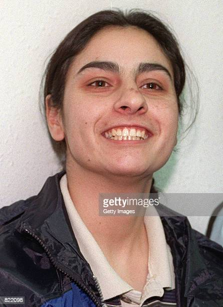 Amani Mona a Palestinian woman suspected of collaborating in the killing of an Israeli teenager smiles as she appears in court March 18 2001 at an...