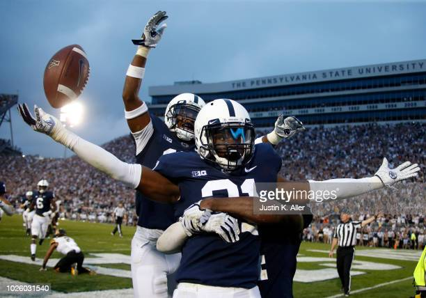 Amani Oruwariye of the Penn State Nittany Lions celebrates after intercepting a pass in overtime to clinch the win against the Appalachian State...