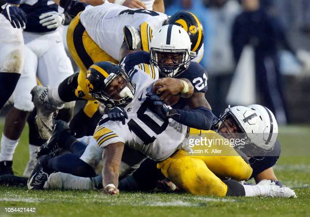 Amani Oruwariye of the Penn State Nittany Lions tackles Mekhi Sargent of the Iowa Hawkeyes on October 27, 2018 at Beaver Stadium in State College,...