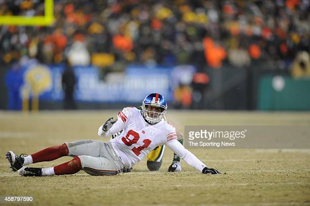 Amani Toomer of the New York Giants falls down during a game against the Green Bay Packers on January 20 2008 at Lambeau Field in Green Bay Wisconsin