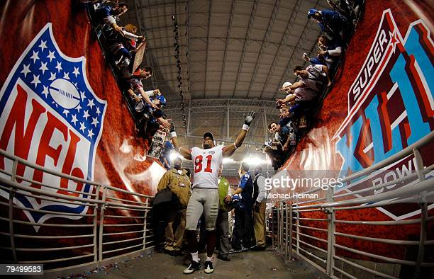 Amani Toomer of the New York Giants walks off the field after defeating the New England Patriots 1714 in Super Bowl XLII on February 3 2008 at the...