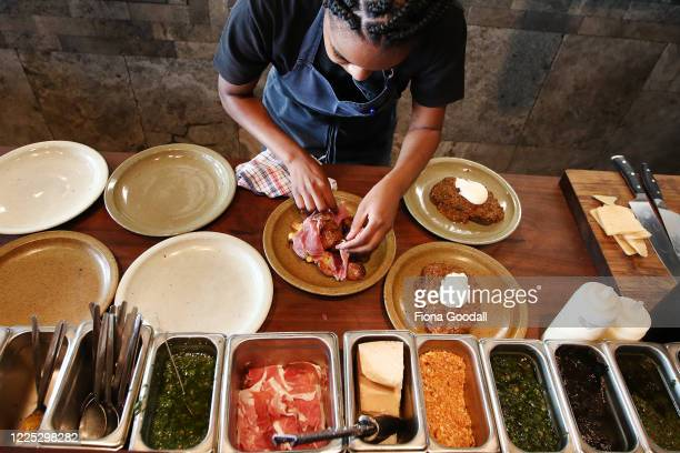 Amano Restaurant chef Nomvulla Sikhakhane plates meals as the restaurant opens for the first time in level two on May 17, 2020 in Auckland, New...