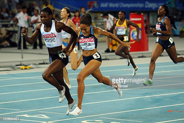 Amantle Montsho of Botswana and Allyson Felix of United States cross the finish line during competes in the women's 400 metres final during day three...