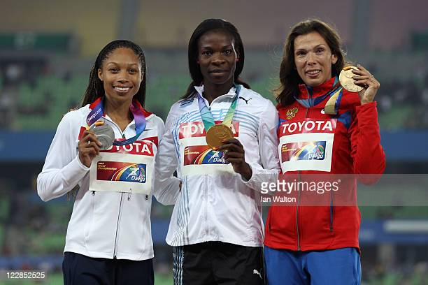 Amantle Montsho of Botswana holds her gold medal Allyson Felix of the USA her silver medal and Anastasiya Kapachinskaya of Russia her bronze after...