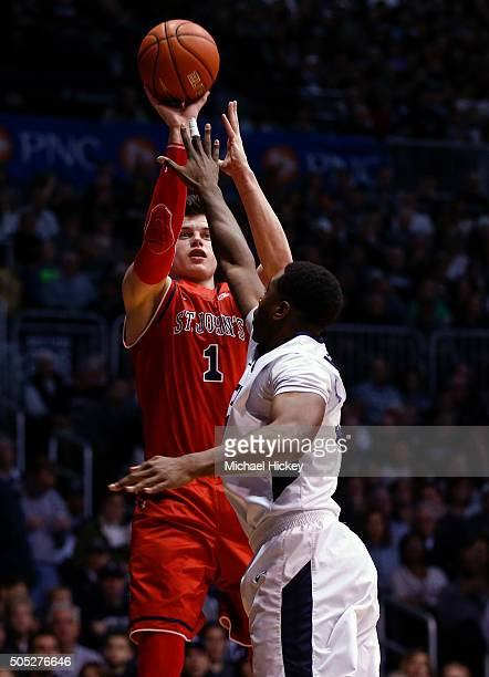Amar Alibegovic of the St John's Red Storm shoots the ball against Kelan Martin of the Butler Bulldogs at Hinkle Fieldhouse on January 16 2016 in...