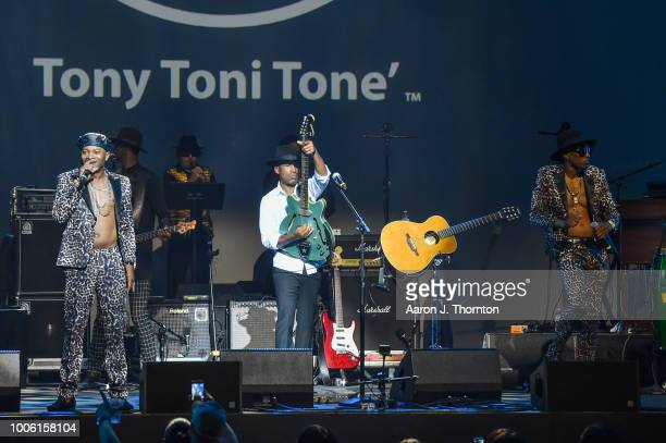 Amar Khalil Dwayne Wiggins and Raphael Saadiq of the singing group Tony Toni Tone perform on stage at The Soundboard Motor City Casino on July 26...