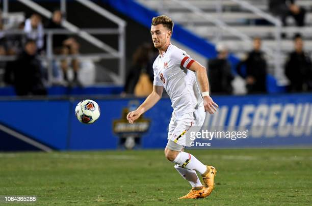 Amar Sejdic of the Maryland Terrapins brings the ball up the field against the Akron Zips during the Division I Men's Soccer Championship held at...