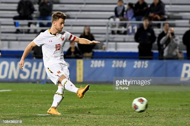 Amar Sejdic of the Maryland Terrapins scores on a penalty kick against the Akron Zips during the Division I Men's Soccer Championship held at...