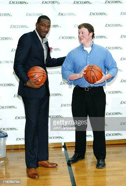 Amar Stoudemire and Walt Arnett attend the Excedrin What's Your Headache Contest sports charity launch at Chelsea Piers Sports Center on June 15 2011...