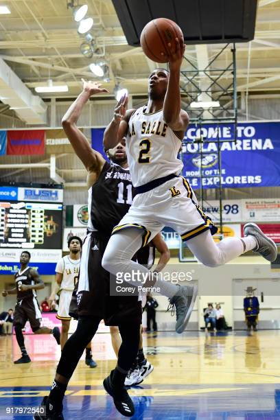 Amar Stukes of the La Salle Explorers drives to the basket against Courtney Stockard of the St Bonaventure Bonnies during the second half at Tom Gola...