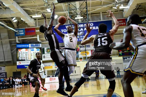 Amar Stukes of the La Salle Explorers drives to the basket against Matt Mobley of the St Bonaventure Bonnies during the second half at Tom Gola Arena...