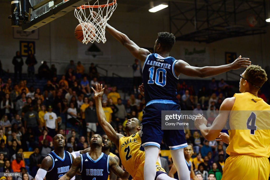 Amar Stukes #2 of the La Salle Explorers is fouled by Cyril Langevine #10 of the Rhode Island Rams during overtime at Tom Gola Arena on February 20, 2018 in Philadelphia, Pennsylvania. Rhode Island edged La Salle 95-93 in overtime.