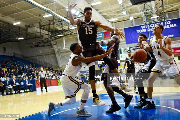Amar Stukes of the La Salle Explorers is fouled by LaDarien Griffin as Matt Mobley of the St Bonaventure Bonnies pressures during the second half at...