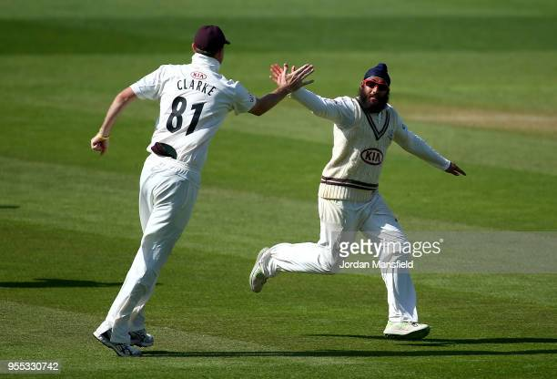 Amar Virdi of Surrey celebrates dismissing Ben Cox of Worcestershire during day three of the Specsavers County Championship Division One match...