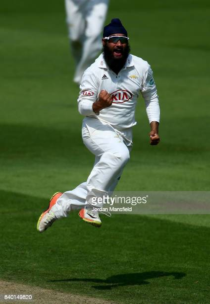 Amar Virdi of Surrey celebrates dismissing Stevie Eskinazi of Middlesex during day one of the Specsavers County Championship Division One match...