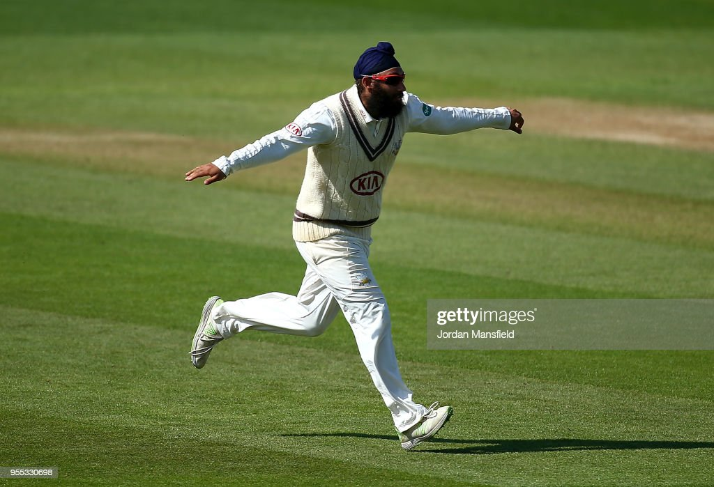 Amar Virdi of Surrey celebrates dismissing Travis Head of Worcestershire during day three of the Specsavers County Championship Division One match between Surrey and Worcestershire at The Kia Oval on May 6, 2018 in London, England.