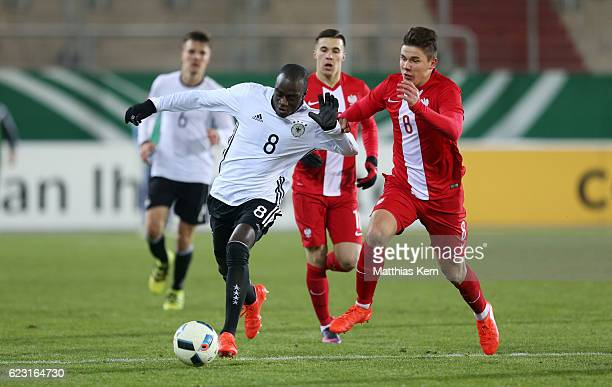 Amara Conde of Germany battles for the ball with Damian Rasak of Poland during the U20 international friendly match between Germany and Poland at...