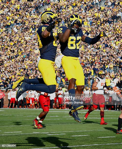 Amara Darboh of the Michigan Wolverines celebrates his first half touchdown with teammate Jake Butt while playing the Maryland Terrapins on November...