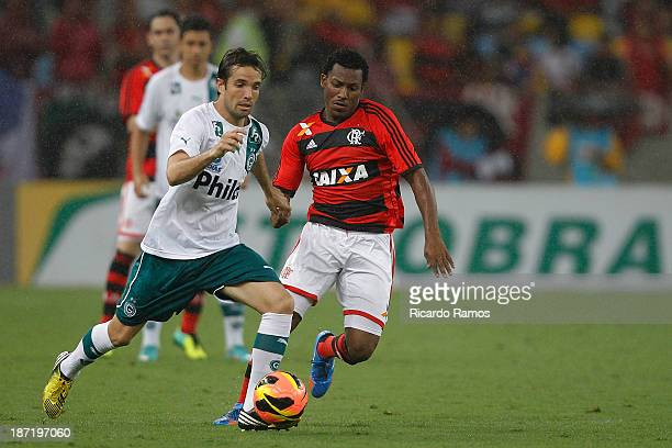 Amaral of Flamengo fights for the ball with a player of Goias during the match between Flamengo and Goias for the Brazilian Cup 2013 at Maracana on...