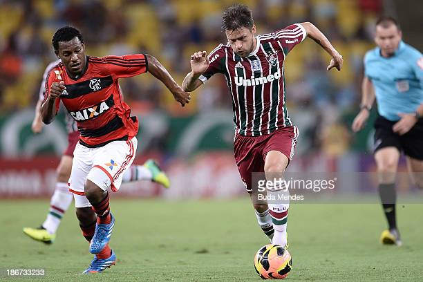 Amaral of Flamengo struggles for the ball with a Rafael Sobis of Fluminense during a match between Flamengo and Fluminense as part of Brazilian Serie...