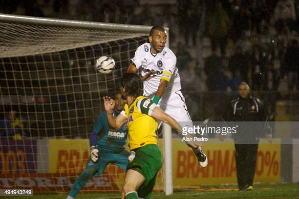 Amaral#5 of Goias struggles for the ball with Germano of Coritiba during a match between Coritiba and Goias for the Brazilian Series A 2014 at Vila...
