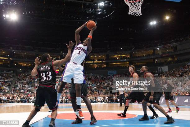 Amare Stoudamire of the Phoenix Suns tries to get a shot off against Willie Green of the Philadelphia 76ers during a preseason game as part of the...