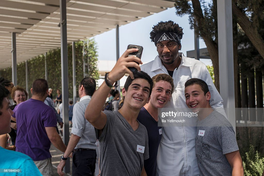 Amar'e Stoudemire a former NBA player seen reacting to childern fans during a visit to Israel Museum on August 9, 2016 in Jerusalem, Israel. Amar'e joined Israeli team Hapoel Jerusalem