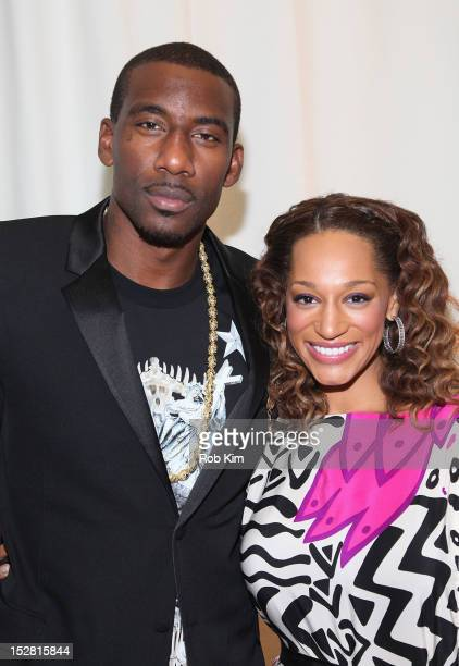 Amar'e Stoudemire and Alexis Welch attend the A Year In A New York Minute photo exhibition opening at Canoe Studios on September 26 2012 in New York...