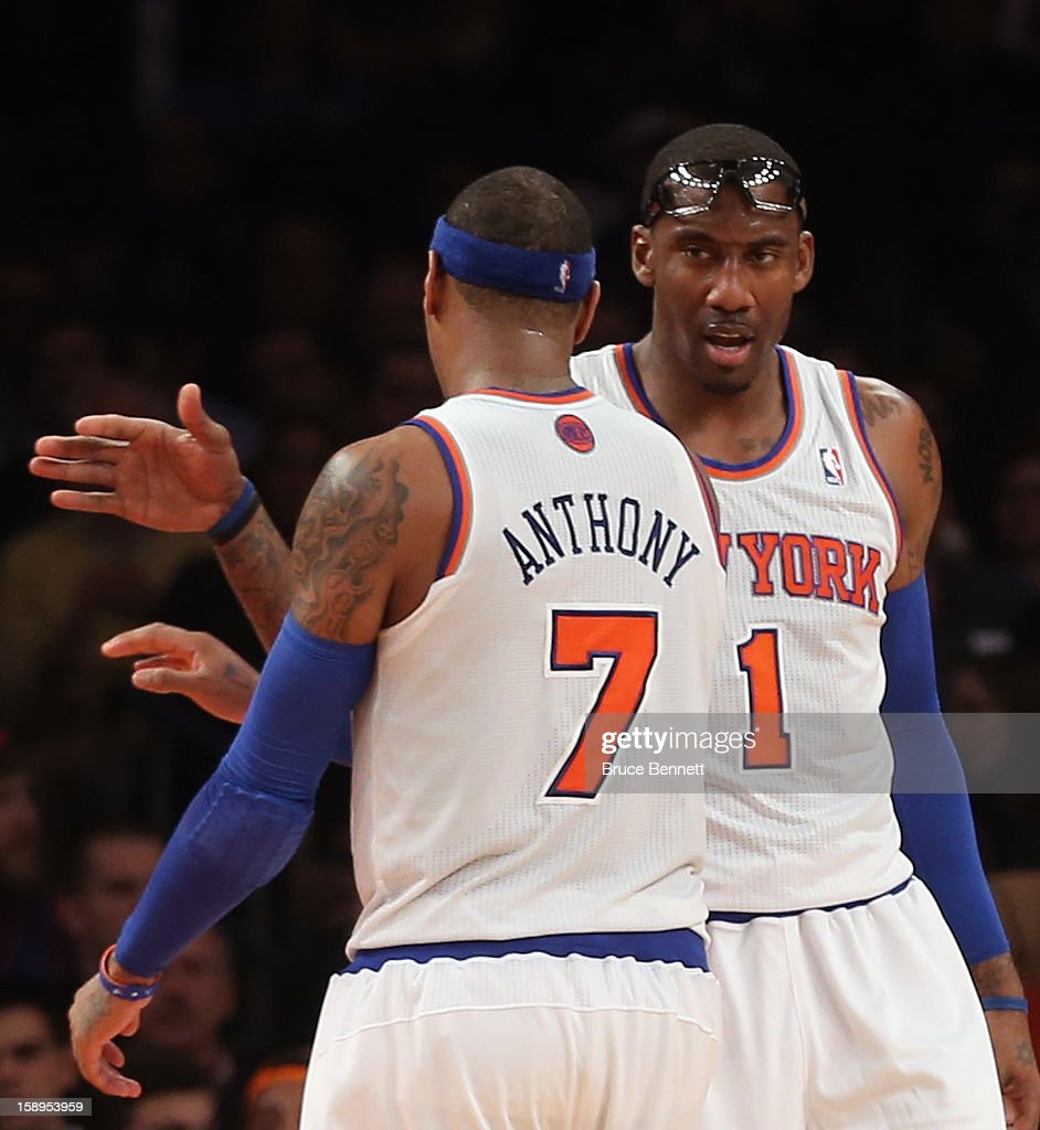 Amar'e Stoudemire #1 and Carmelo Anthony #7 of the New York Knicks celebrate a basket late in the game against the San Antonio Spurs at Madison Square Garden on January 3, 2013 in New York City.