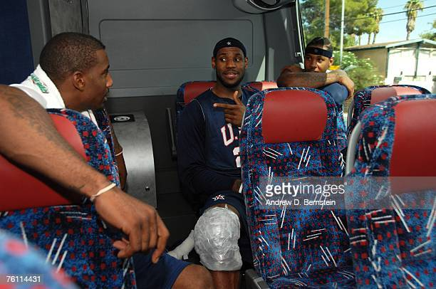 Amare Stoudemire LeBron James and Carmelo Anthony of the USA Basketball Men's Senior National Team ride together on the bus back to the hotel after...