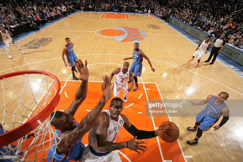 Amar'e Stoudemire #1 of New York Knicks shoots against Serge Ibaka #9 of the Oklahoma City Thunder on March 7, 2013 at Madison Square Garden in New York City.