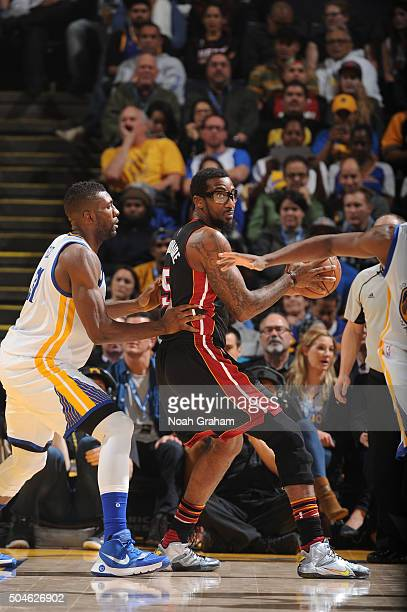 Amar'e Stoudemire of the Miami Heat posts up against Fetus Ezeli of the Golden State Warriors on January 11 2016 at Oracle Arena in Oakland...