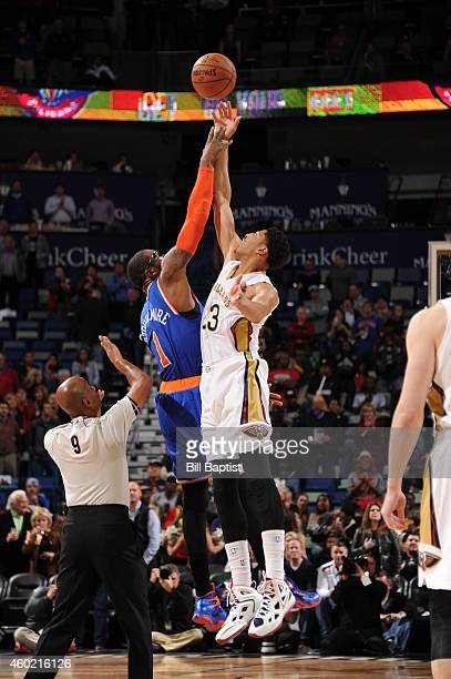 Amar'e Stoudemire of the New York Knicks and Anthony Davis of the New Orleans Pelicans go up for the opening tip off on December 9, 2014 at the...