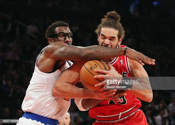 Amar'e Stoudemire of the New York Knicks blocks Joakim Noah of the Chicago Bulls during the second quarter at Madison Square Garden on December 11...