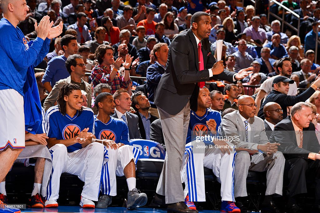 Amar'e Stoudemire #1 of the New York Knicks cheers his teammates on from the sideline against the Boston Celtics in Game Five of the Eastern Conference Quarterfinals during the 2013 NBA Playoffs on May 1, 2013 at Madison Square Garden in New York City