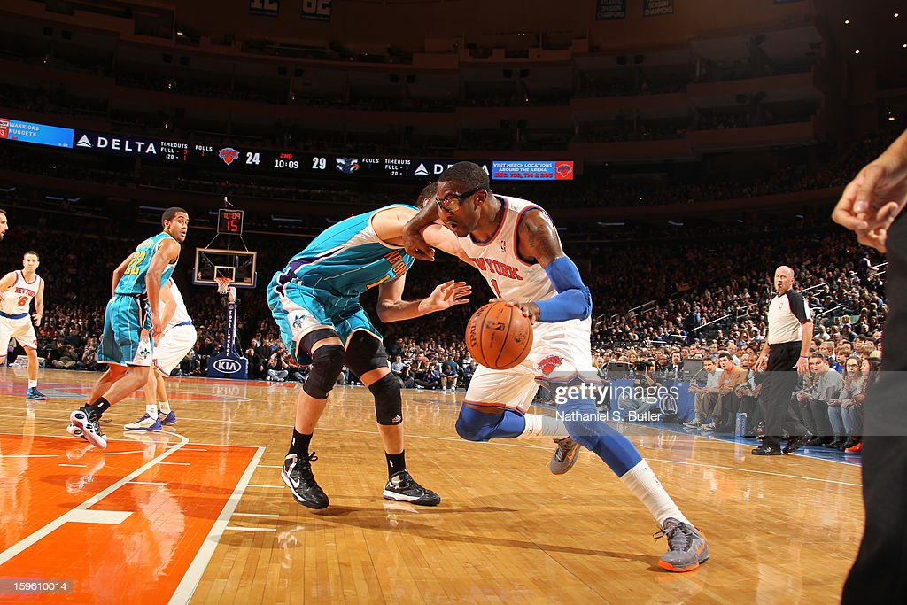 Amar'e Stoudemire #1 of the New York Knicks drives against the New Orleans Hornets on January 13, 2013 at Madison Square Garden in New York City.