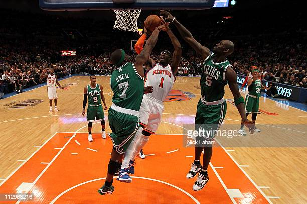 Amar'e Stoudemire of the New York Knicks drives for a shot attempt against Jermaine O'Neal and Kevin Garnett of the Boston Celtics in Game Three of...