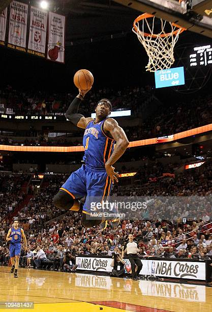 Amar'e Stoudemire of the New York Knicks dunks during a game against the Miami Heat at American Airlines Arena on February 27 2011 in Miami Florida...