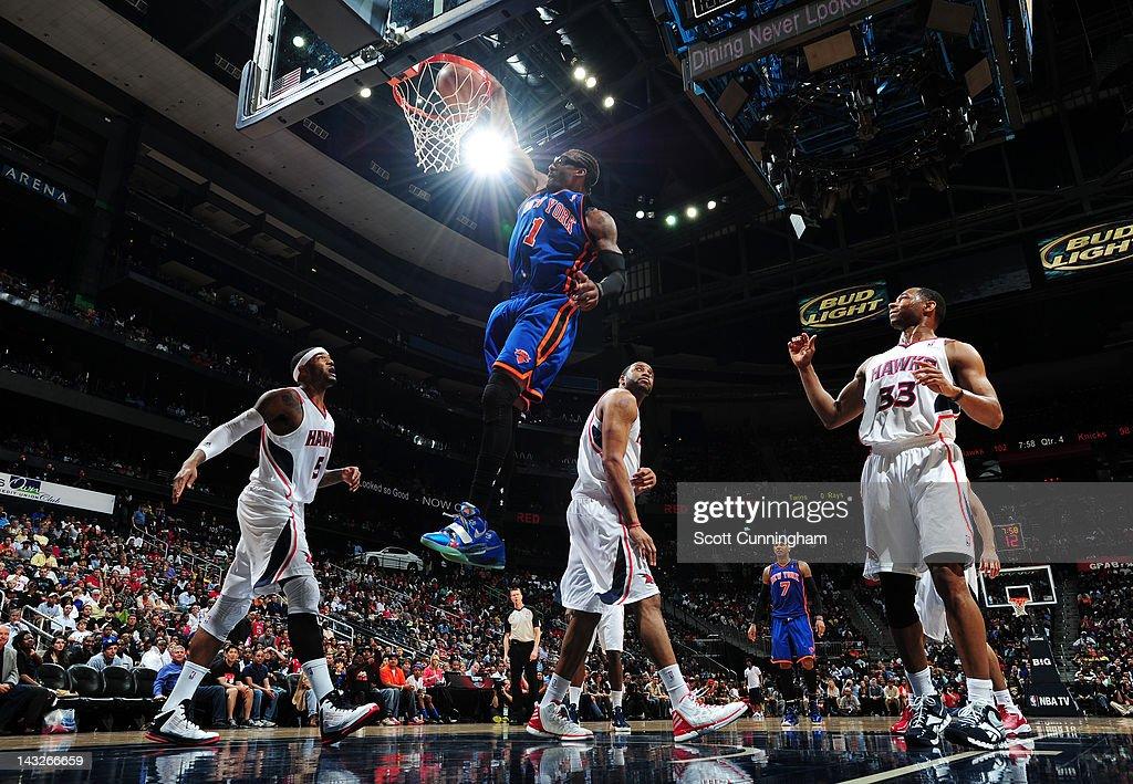 Amar'e Stoudemire #1 of the New York Knicks dunks over Josh Smith #5 of the Atlanta Hawks on April 22, 2012 at Philips Arena in Atlanta, Georgia.