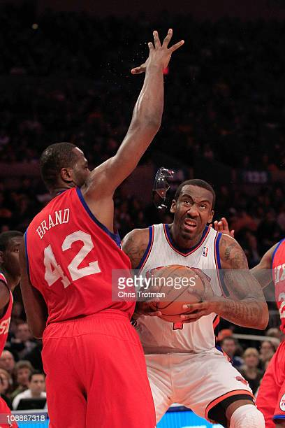 Amar'e Stoudemire of the New York Knicks glasses fly in to the air as he shoots over Elton Brand of the Philadelphia 76ers at Madison Square Garden...