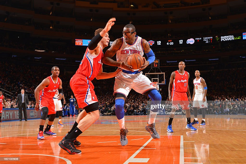 Amar'e Stoudemire #1 of the New York Knicks handles the ball against Blake Griffin #32 of the Los Angeles Clippers on February 10, 2013 at Madison Square Garden in New York City.