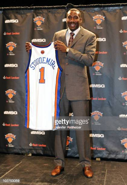 Amar'e Stoudemire of the New York Knicks poses for a photo with his new jersey during a press conference on July 8 2010 at Madison Square Garden in...