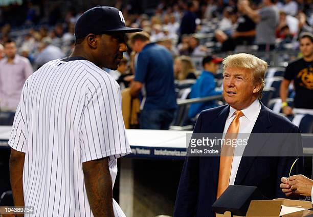 Amar'e Stoudemire of the New York Knicks talks to Donald Trump prior to the game between the New York Yankees and the Tampa Bay Rays on September 23...