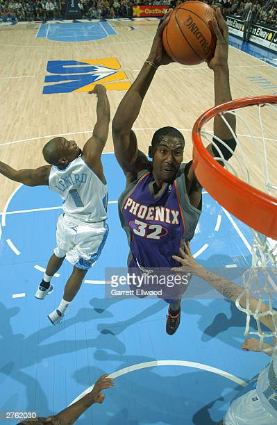 Amare Stoudemire of the Pheonix Suns dunks against the Denver Nuggets at the Pepsi Center November 25 2003 in Denver Colorado NOTE TO USER User...